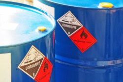 Hazardous waste storage drums. Thrival Company offers Hazardous Waste Management consulting services.