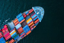 Cargo ship stacked full of colorful containers. IMDG dangerous goods shipping.