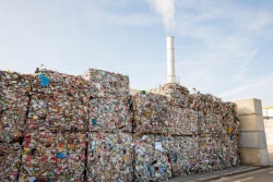 Smokestack and landfill compressed solid waste